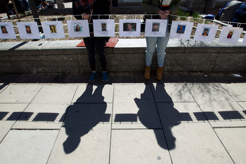 ". Demonstrators hold up pictures from students killed in different years, during the ""March for Our Lives\"" rally in support of gun control in Washington, Saturday, March 24, 2018, on Pennsylvania Avenue near the U.S. Capitol. (AP Photo/Jose Luis Magana)"