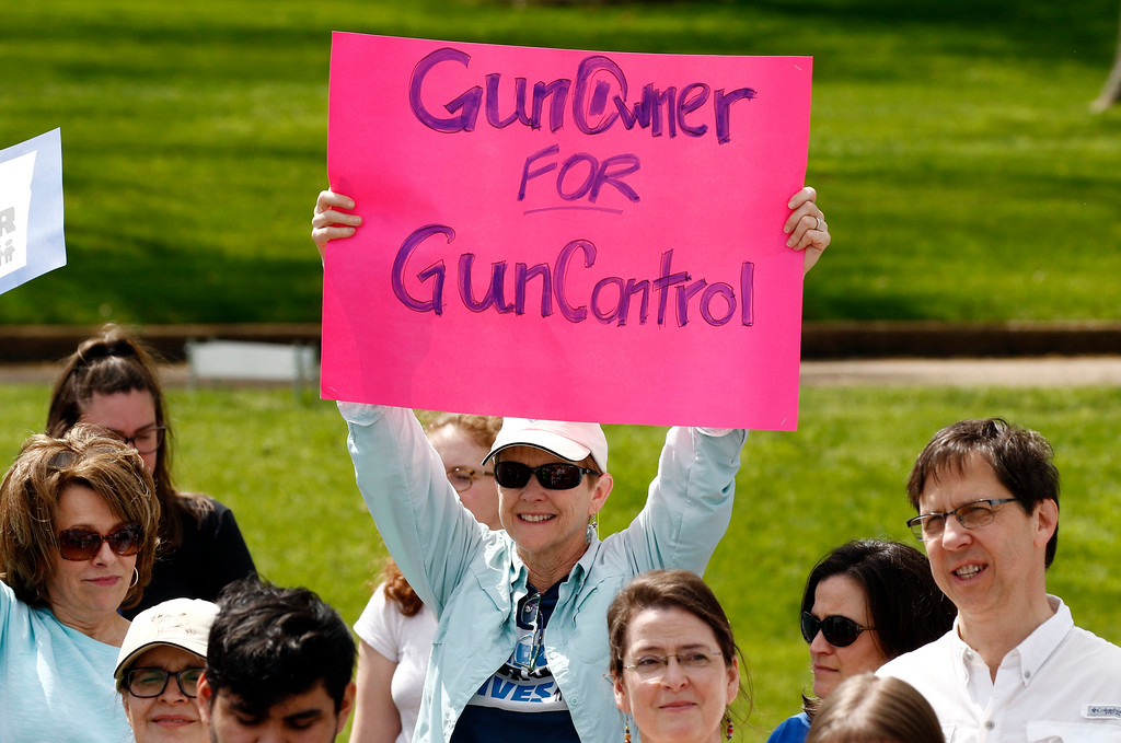 """. A sign carrier offers her message in support of the several hundred students, parents, concerned citizens and anti-gun advocates who marched in downtown Jackson, Miss., Saturday, March 24, 2018, to demand stricter gun laws in the U.S. The rally was one of several being held across Mississippi and the United States. Protesters held signs and chanted as they marched from the Mississippi State Supreme Court to the Governor\'s Mansion and back again to the building across from the state Capitol where the Legislature was in session, for the \""""March for Our Lives\"""" rally. (AP Photo/Rogelio V. Solis)"""
