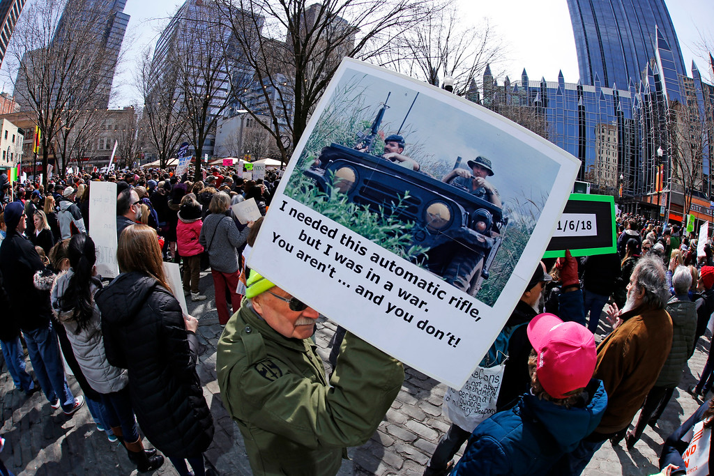 ". Vietnam veteran Jim Roberts of Pittsburgh, holds a sign during a Gun Control Rally in Market Square in downtown Pittsburgh, Saturday, March 24, 2018. A series of protests held across the United States Saturday in support of gun control is shaping up to be one of the biggest youth protests since the era of the Vietnam War. The ""March for Our Lives\"" rallies are a call to action by student survivors of last month\'s school shooting in Florida that left 17 people dead. (AP Photo/Gene J. Puskar)"