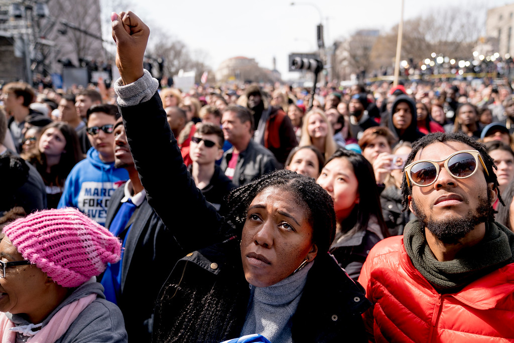 ". Members of the audience hold up clenched fists as the ""March for Our Lives\"" rally in support of gun control comes to an end in Washington, Saturday, March 24, 2018. (AP Photo/Andrew Harnik)"