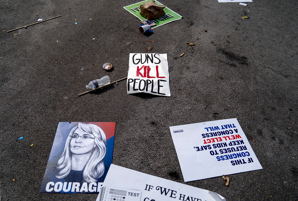 ". Posters aare strewn along Pennsylvania Avenue following the ""March for Our Lives\"" rally in support of gun control in Washington, Saturday, March 24, 2018. (AP Photo/Andrew Harnik)"