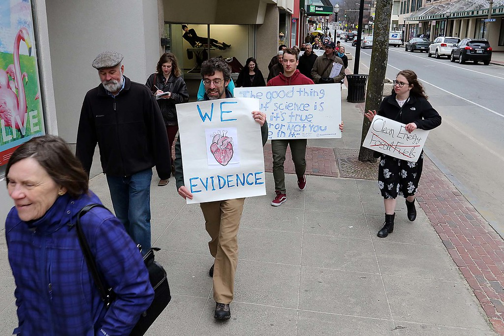. About 100 people march down Main Street during the March for Science in Fitchburg on Saturday afternoon. SENTNEL & ENTERPRISE/JOHN LOVE