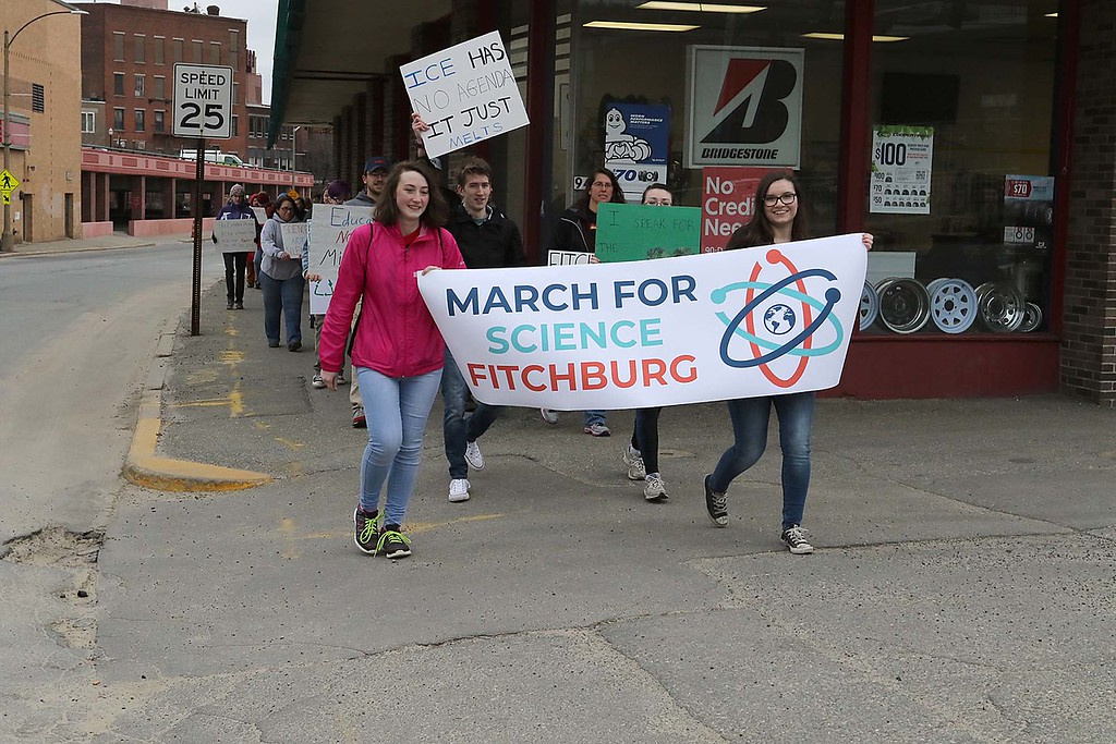 . About 100 people march down Boulder Drive during the March for Science in Fitchburg on Saturday afternoon. SENTNEL & ENTERPRISE/JOHN LOVE