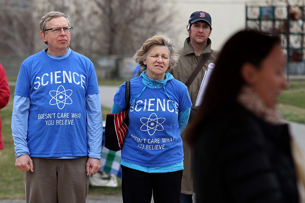 . Warren and Janet Tuiskula from Fitchurg listens to the speakers at Riverfront Park during the March for Science in Fitchburg on Saturday afternoon. SENTNEL & ENTERPRISE/JOHN LOVE