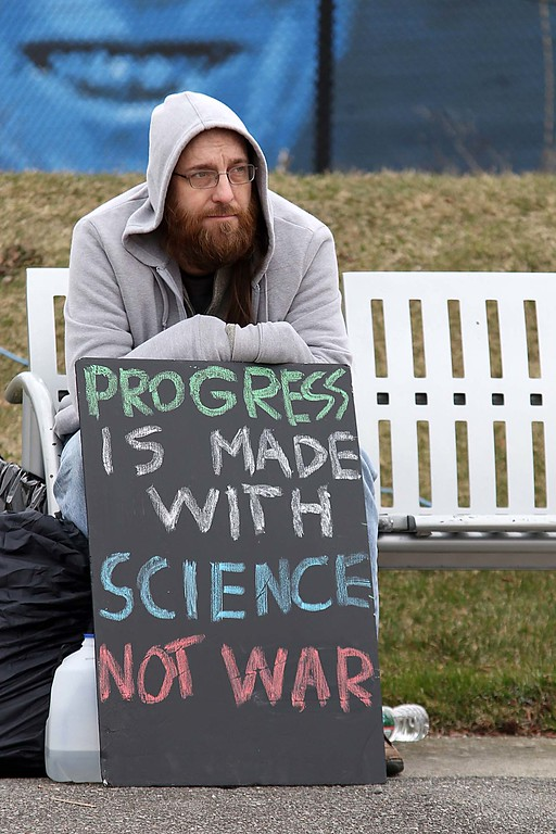 . Michael Gallagher from Lunenburg listens to the speakers while holding a sign at the March for Science in Fitchburg on Saturday afternoon. SENTNEL & ENTERPRISE/JOHN LOVE