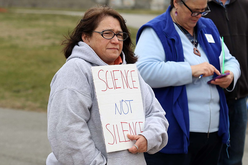 . Angela Saball from Fitchburg holds a sign at the March for Science in Fitchburg on Saturday afternoon. SENTNEL & ENTERPRISE/JOHN LOVE