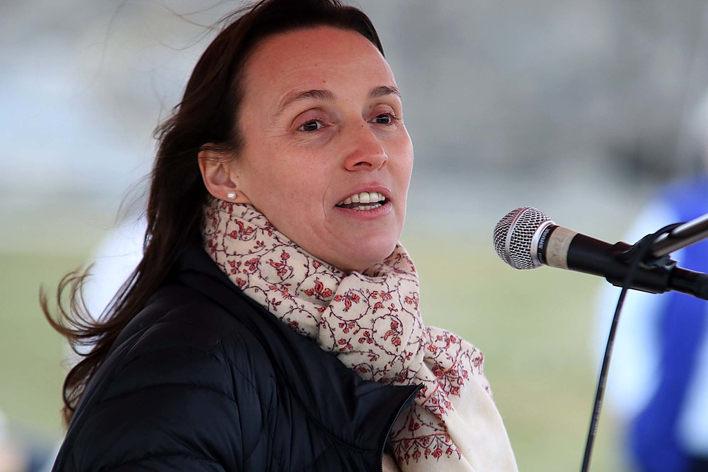 . Dr. Tatjana Kobb addresses the crowd at Riverfront Park during the March for Science in Fitchburg on Saturday afternoon. SENTNEL & ENTERPRISE/JOHN LOVE