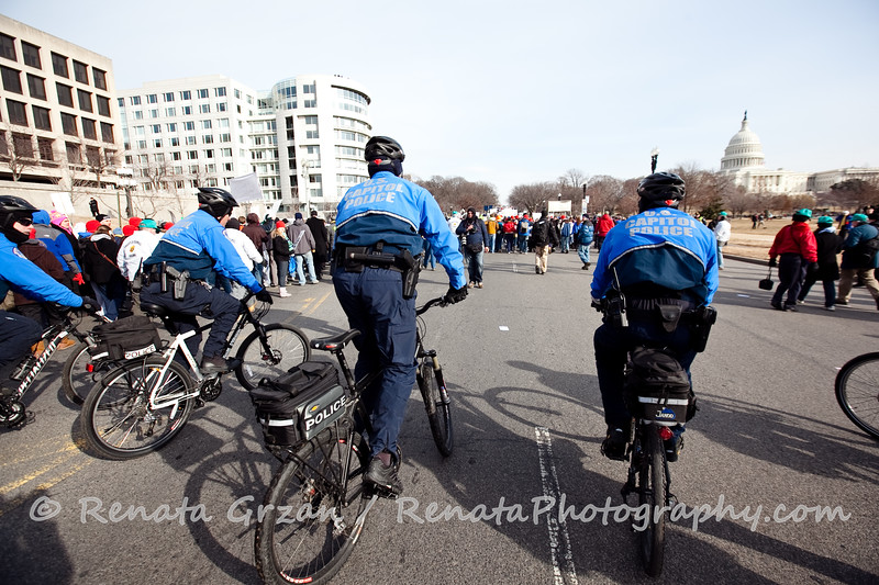 # 80 Police had to change course and push the marchers off the road that were ahead of the start banner.