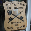 """On display in the lobby at City Hall,  this plaque has the """"Keys to the City"""" made from a sword and rifle barrel discovered along the route of the Expedition."""