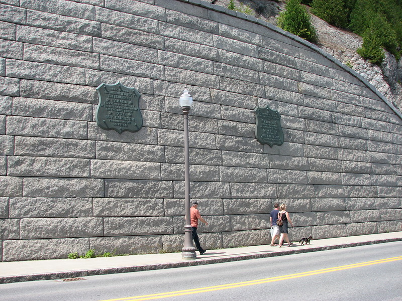 View from across the street of the plaques, now mounted on a retaining wall along Boulevard Champlain