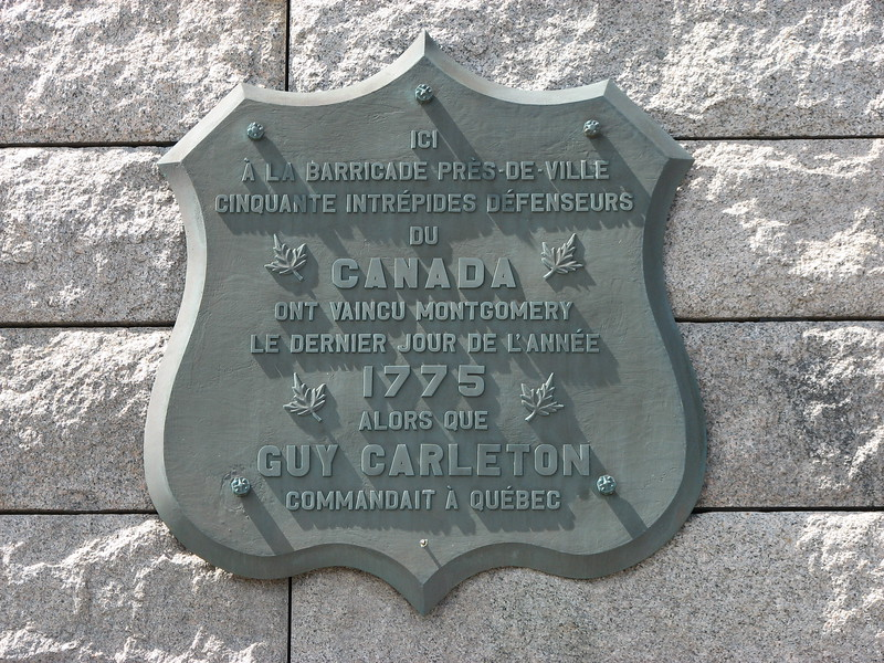 The right-hand plaque, in French