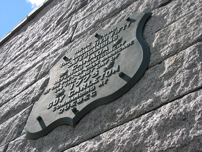 View from the sidewalk beneath the plaques