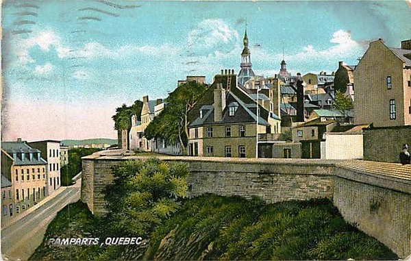 Old postcard view, circa 1910. The yellow house in the center of the picture is now 51 rue des Ramparts. The terrace from which Arnold was shot is the prominent angle in the wall to its left. The building with the dormers on the lower street is still there, and the building with the plaque about Arnold's wounding is just out of view on the left.
