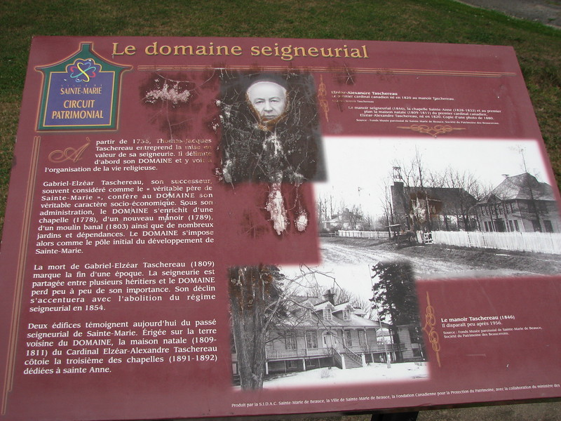 Interpretive panel situated between the church and the manor
