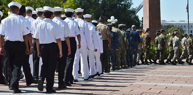Members of US navy and other military marching in 9/11 anniversary commemoration in Denver.