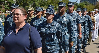 Members of US Navy wearing combat fatigues, march in 9/11 anniversary commemoration.