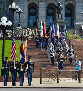 Members of US military marching down stairs at Colorado State Capitol building at 9/11 15th Anniversary commeroration.