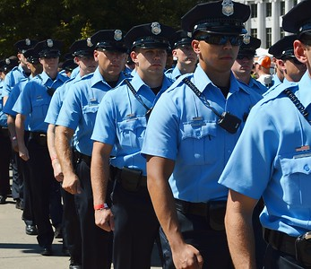 Denver Police officers march at 9/11 anniversary commemoration.