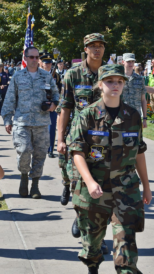 Young woman, member of the Civil Air Patrol, marches in a 9/11 anniversary commemoration.