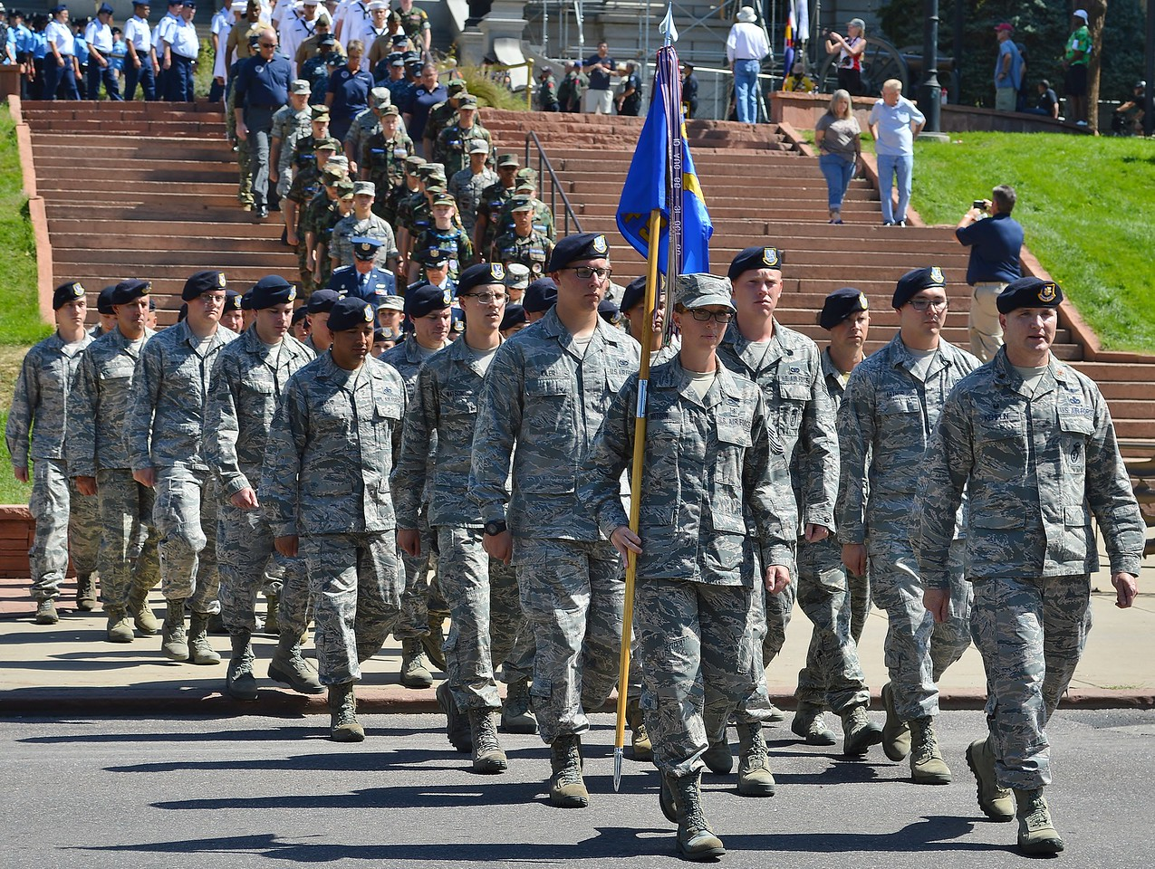 Members of US military marching down stairs at Colorado State Capitol building at 9/11 15th Anniversary commemoration.