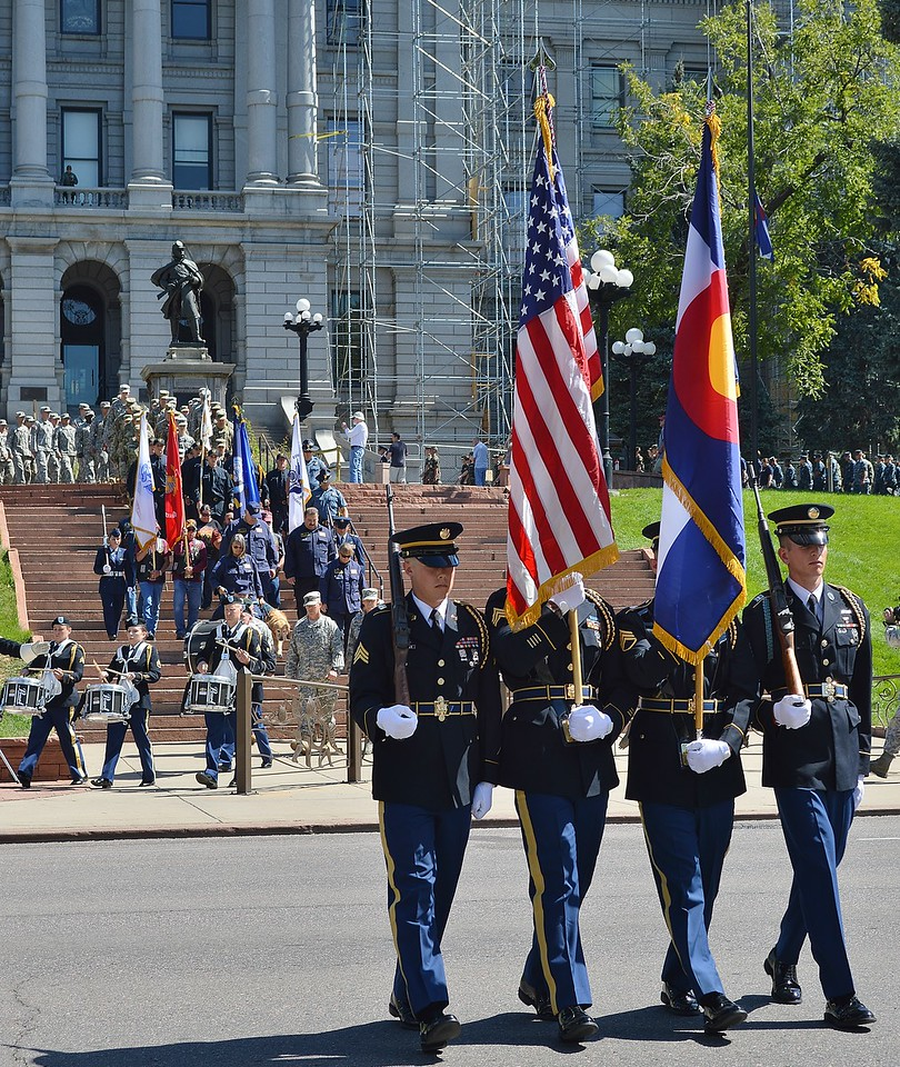Military color guard leading march on 9/11 anniversary.