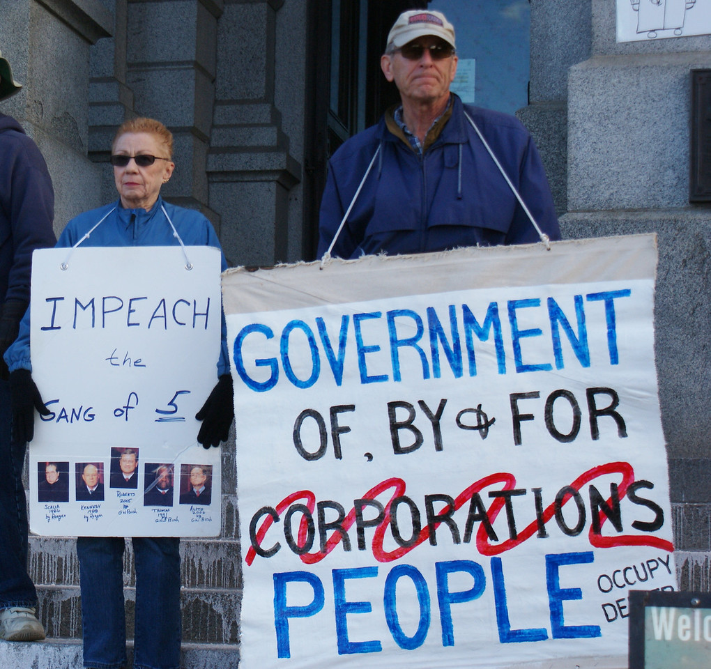 "Denver area residents demonstrate against ""corporate personhood"" and the ""Citizens United"" decision by the U.S. Supreme Court, that allowed unlimited corporate spending on elections."