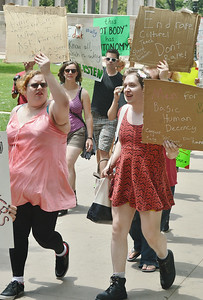Protesters marching with anti-rape signs.