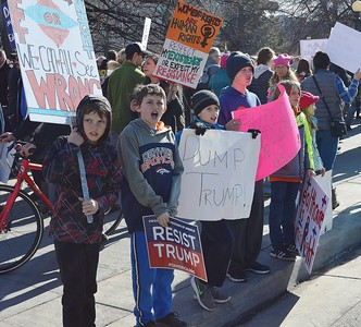 Group of young kids holding signs and chanting at Women's March On Denver.
