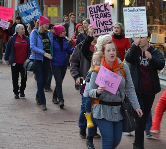 This woman and young daughter were among the marchers on International Women's Day in Boulder, Co.