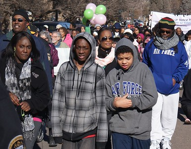 African-American youth march in the MLK Day parade in Denver.