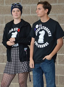"""Two high school students at school protest, both wearing """"Jeffco Students For Change"""" t-shirts."""