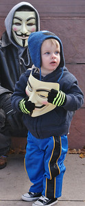 """Parents with small children were among protesters joining the """"Million Mask March"""", in Denver. (11/5/13)"""
