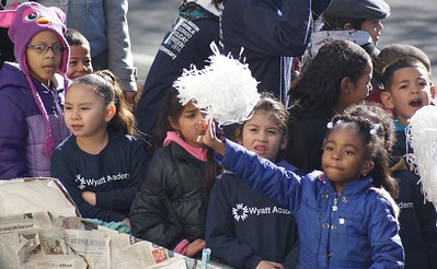 Young Wyatt Acadamy students ride in the back of a pick-up truck at MLK Day parade in Denver.