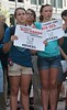 Two young girls hold anti KXL pipeline signs at protest.