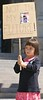 """Young girl, standing, holding """"Not In My Future"""" sign at KXL pipeline protest."""