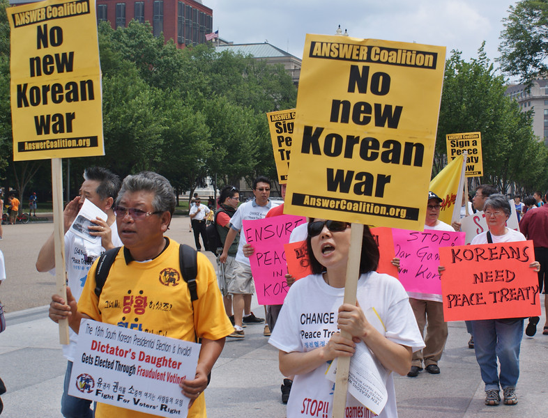 Demonstrators in front of the White House call on the Obama administration to begin negotiations for a peace treaty with North Korea. The Korean War concluded with an armistice that ended the fighting, but no official peace treaty was ever signed.(7/27/13)