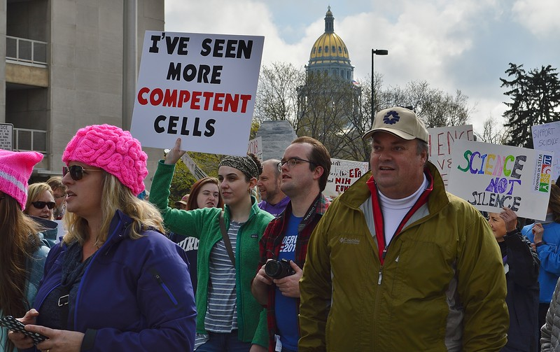 The Colorado State Capitol building serves as a backdrop for Denver's March For Science.
