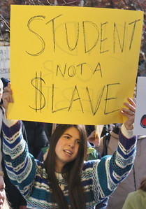 The high cost of education was a concern of this young woman at an occupy march in Denver.