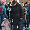 Little girl walking with mother in Women's March On Denver