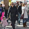 Little girl walking with mother in Women's March On Denver.