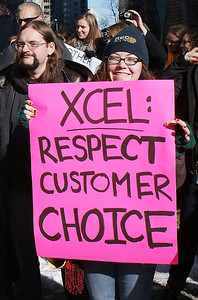 Xcel Energy customer demonstrating support for rooftop solar at the companies offices in Denver.