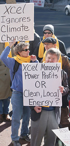 Colorado residents demonstrate opposition to utility company Xcel Energy's policies on rooftop solar energy, at a demonstration outside the company's offices in Denver.