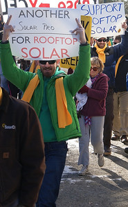 This solar energy worker demonstrates against the policies of utility corporation, Xcel Energy, at a protest near the companies offices in Denver.
