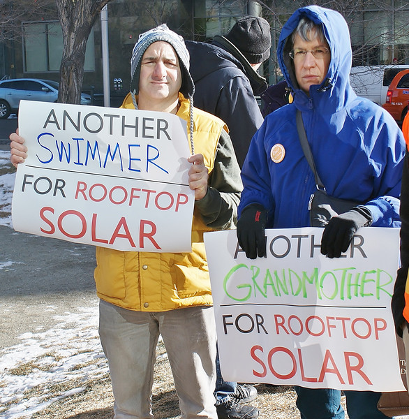 This grandmother was among protesters supporting rooftop solar energy at a demonstration near the offices of utility corporation Xcel Energy, in Denver.