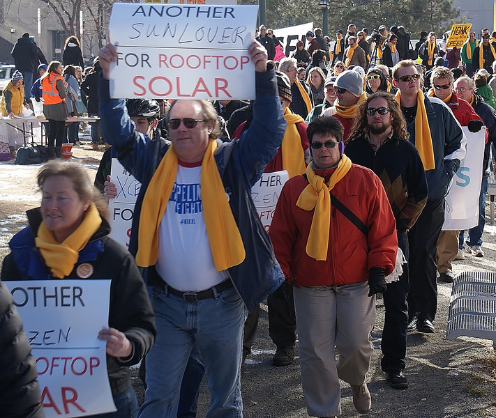 Rooftop solar energy supporters marched to the corporate offices of Xcel Energy to protest the companie's metering policies.