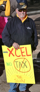 This VietNam veteran demonstrates support for rooftop solar energy at the Denver offices of the utility company Xcel energy, in Denver.