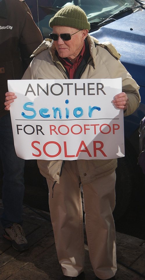 This Colorado man was among many seniors supporting rooftop  solar energy at a protest outside the electric utility company, Xcel, in Denver.