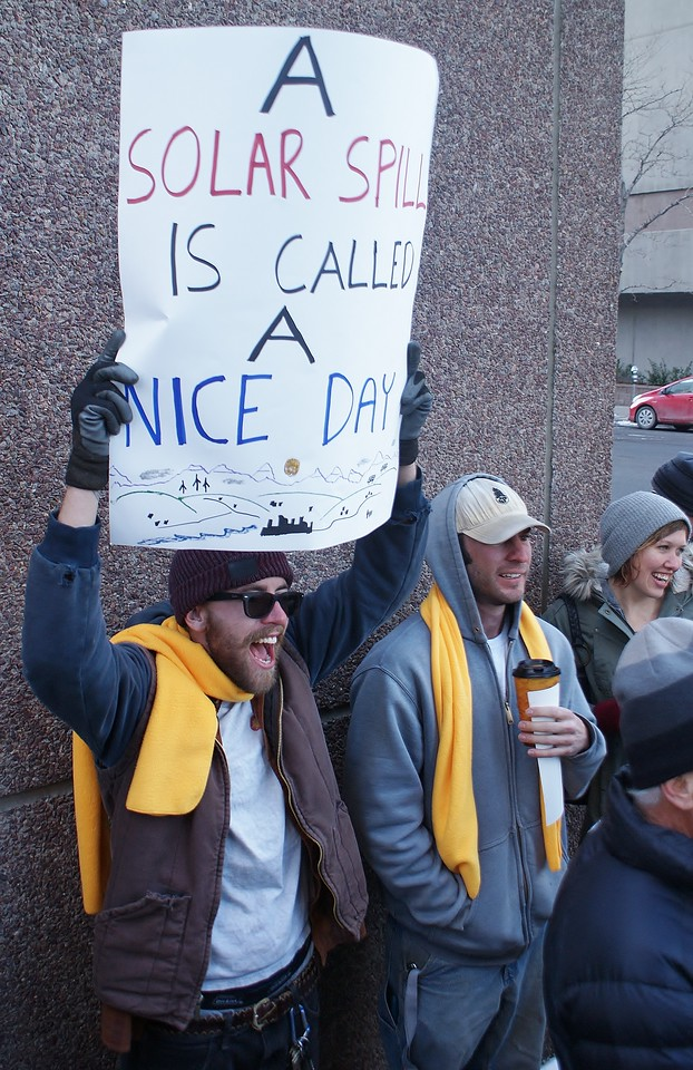 These rooftop solar energy advocates demonstrate near the offices of utility corporation Xcel Energy, in Denver
