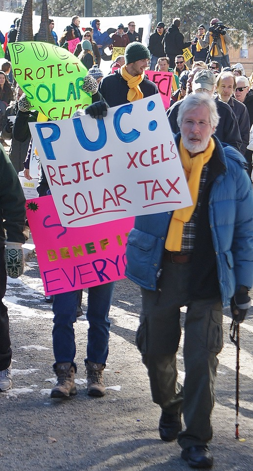 Demonstrators protest the policies of utility corporation, Xcel Energy at a pro rootop solar  energy rally in Denver.
