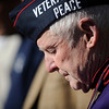 """To mark Veterans Day, members of Veterans for Peace, Iraq Veterans Against the War, and Military Families Speak Out unveil the electronic """"cost of war"""" sign and read the names of troops from New York state who were killed in the wars in Iraq and Afghanistan."""